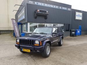 Jeep cherokee 1999 blauw/creme
